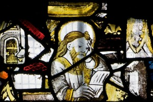 A religious man reading, a detail from a fifteenth century window at the All Saints' Church, Gresford.