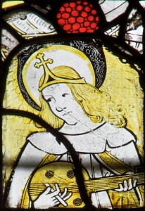 An angel playing a musical instrument, a detail from a fifteenth-century window at the All Saints' Church, Gresford.